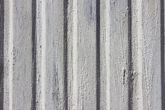 Cement on metal wall Stock Photo