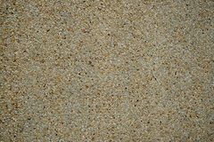 Cement mixed small gravel stone wall royalty free stock image