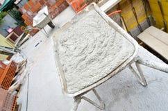 Cement is mixed in a wheelbarrow Royalty Free Stock Photos