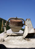 Cement mixer. Old cement mixer at a construction site royalty free stock image