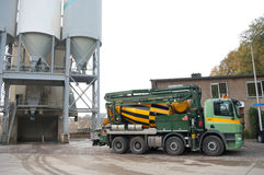 Cement mixer. Truck parked next to silos royalty free stock photos
