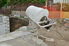 Cement mixer. Old fashioned cement mixer on building site royalty free stock photos