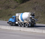 Cement Mixer. Cement Truck on the Highway Stock Photos