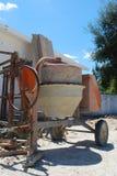 Cement mixer. Orange cement mixer at a construction site Stock Image