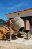 Cement mixer. Orange cement mixer at a construction site Stock Photography