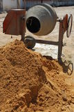 Cement mixer. Orange cement mixer at a construction site Royalty Free Stock Photo