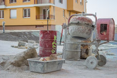 Cement mixer with barrel and plastic cement mixing trough Stock Photos