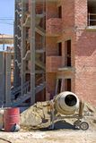 Cement mixer brick building and rubble on Spanish building site Stock Images