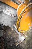 Cement mixer. Close - up of cement mixer at a construction site. Work in progress stock photo