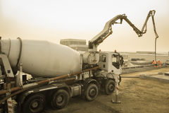 Cement mixer on construction site stock photography