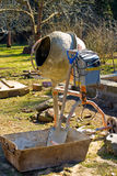 Cement mixer in garden Royalty Free Stock Photo