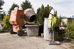 Cement mixer and hats Royalty Free Stock Image