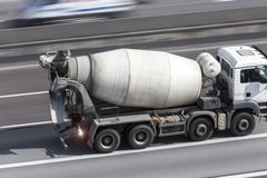 Cement mixer on a highway. A Cement mixer on a highway Stock Photo