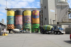 Cement mixer lorry and cement silos. Royalty Free Stock Image