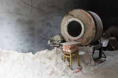 Cement mixer. Machine at construction site, tools and sand stock image