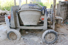 Cement mixer machine. At home construction site royalty free stock photography