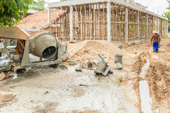 Cement mixer. Old Cement mixer machine with sand truck stop beside at a construction site Stock Photography