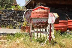 Cement mixer. Old rusty cement mixer on construction site Stock Photos