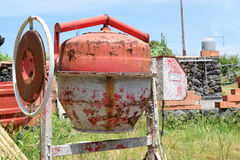 Cement mixer. Old rusty cement mixer on construction site Stock Image