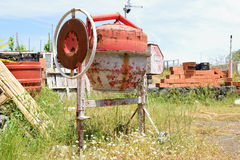 Cement mixer. Old rusty cement mixer on construction site Royalty Free Stock Photography
