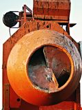 Cement mixer. An orange cement mixer mixing gravel and cement Stock Images