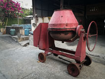Cement mixer. The red cement mixer on the floor Stock Image