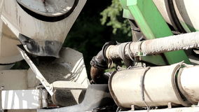 Cement mixer slowly mixing the cement inside. Cement mixer a heavy equipment slowly mixing the cement to properly mix it and use it for construction purposes stock footage