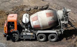 Cement mixer truck. Photo mixers dirty construction site is a side view from the top view Stock Images
