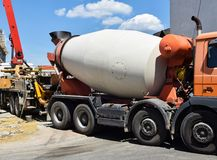 Cement mixer truck at the construction site. Outdoor stock photo