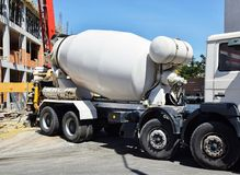 Cement mixer truck at the construction site. Outdoor stock image