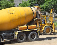 Cement mixer truck. At the construction site Stock Photo