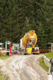 Cement mixer truck. Falcade, Belluno, Italy - August 21, 2015: Cement mixer truck works at building site under construction the new modern cabin lift in the ski stock photo