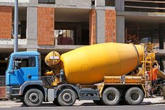 Cement mixer truck next to a construction site. In summer royalty free stock images