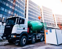 Cement mixer truck Scania on construction site. STRASBOURG, FRANCE - MAR 5, 2018: Scania G410 cement truck at the reconstruction site of the European Parliament stock photography