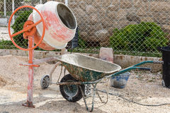 Cement Mixer. A cement mixer with a wheel barrow royalty free stock photography