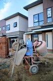 Cement mixer and wheel barrow Stock Photos