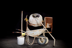 Cement mixer with wheelbarrow Stock Images
