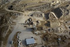 Cement mixing plant. Aerial view of a cement mixing plant and its sand and gravel stockpile Royalty Free Stock Photo