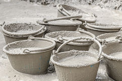 Cement mixing in plastic bucket Royalty Free Stock Image