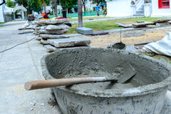 Cement mixing with salver at construction site.  Stock Photo