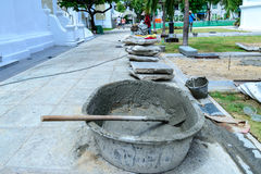 Cement mixing with salver at construction site Stock Image