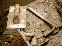 Cement mortar dirty tools like trowel Stock Photo