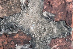 Cement in old brick. Cement cross old brick selective focus Royalty Free Stock Images