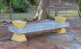 Cement Park Bench. A park bench made of concrete and painted yellow in downtown Cancun, Mexico stock photography