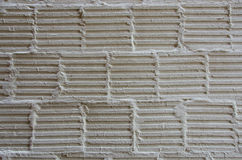 Line Pattern on a Cement Wall. Cement linear markings in brick laying pattern on a wall Stock Images