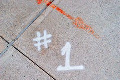 Cement pavement number 1 with red arrow Stock Photos