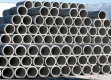 Cement pipes in pile Royalty Free Stock Photography