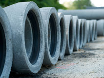 Cement pipes for sewerage rehabilitation in a row. Cement pipes for sewerage rehabilitation for underground work in a row Royalty Free Stock Image