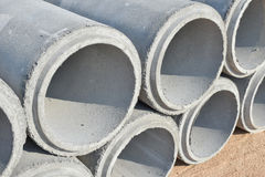 Cement pipes stacking at yard Royalty Free Stock Photos