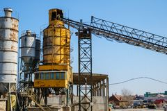 Cement plant factory manufacturing. On blue sky stock images